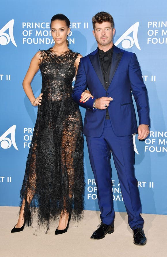 Singer Robin Thicke and his partner April Love Geary announced Tuesday they are expecting their second child together. Here, the couple attendthe Monte-Carlo Gala for the Global Ocean in Monaco on September 28, 2017.