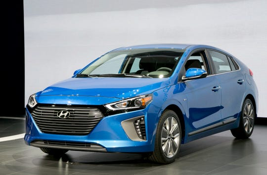 FILE - In this March 23, 2016, file photo, the 2017 Hyundai Ioniq hybrid vehicle is shown at the New York International Auto Show. Like the hybrid benchmark Prius, the Ioniq is a hatchback with ample interior and cargo space. (AP Photo/Mark Lennihan, File)