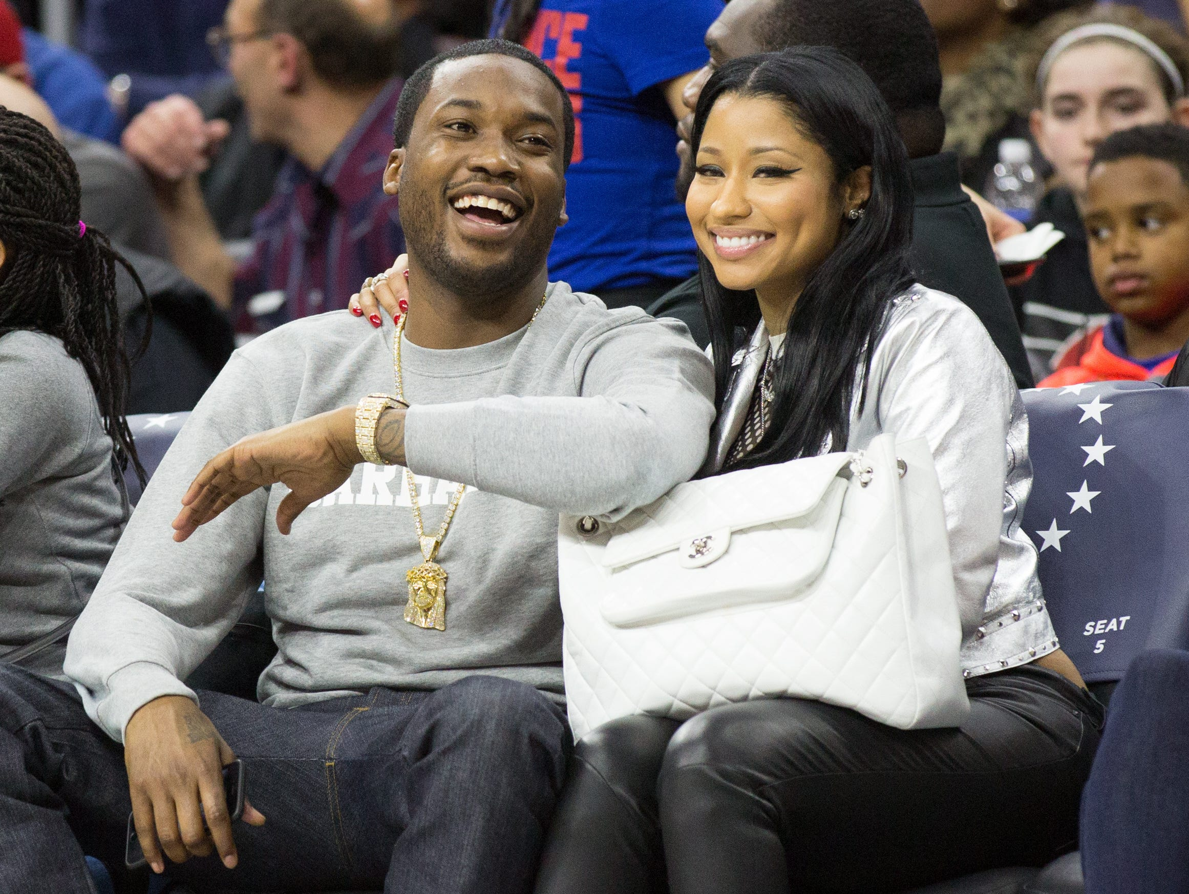 Jan 16, 2016; Philadelphia, PA, USA; Nicki Minaj (R) and Meek Mill (L) watch the game between the Philadelphia 76ers and the Portland Trail Blazers in second half at Wells Fargo Center. The Philadelphia 76ers won 114-89. Mandatory Credit: Bill Streicher-USA TODAY Sports ORG XMIT: USATSI-232506 ORIG FILE ID:  20160116_krj_sq4_130.JPG