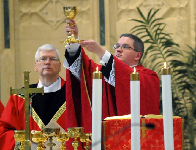 The Rev. Kevin M. Lonergan, right, celebrated his first Mass after ordination June 8, 2014, at St. Patrick's Church in Pottsville, Pa. The 30-year-old Lonergan was charged Aug. 21, 2018, with corruption of minors, a felony, and indecent assault.