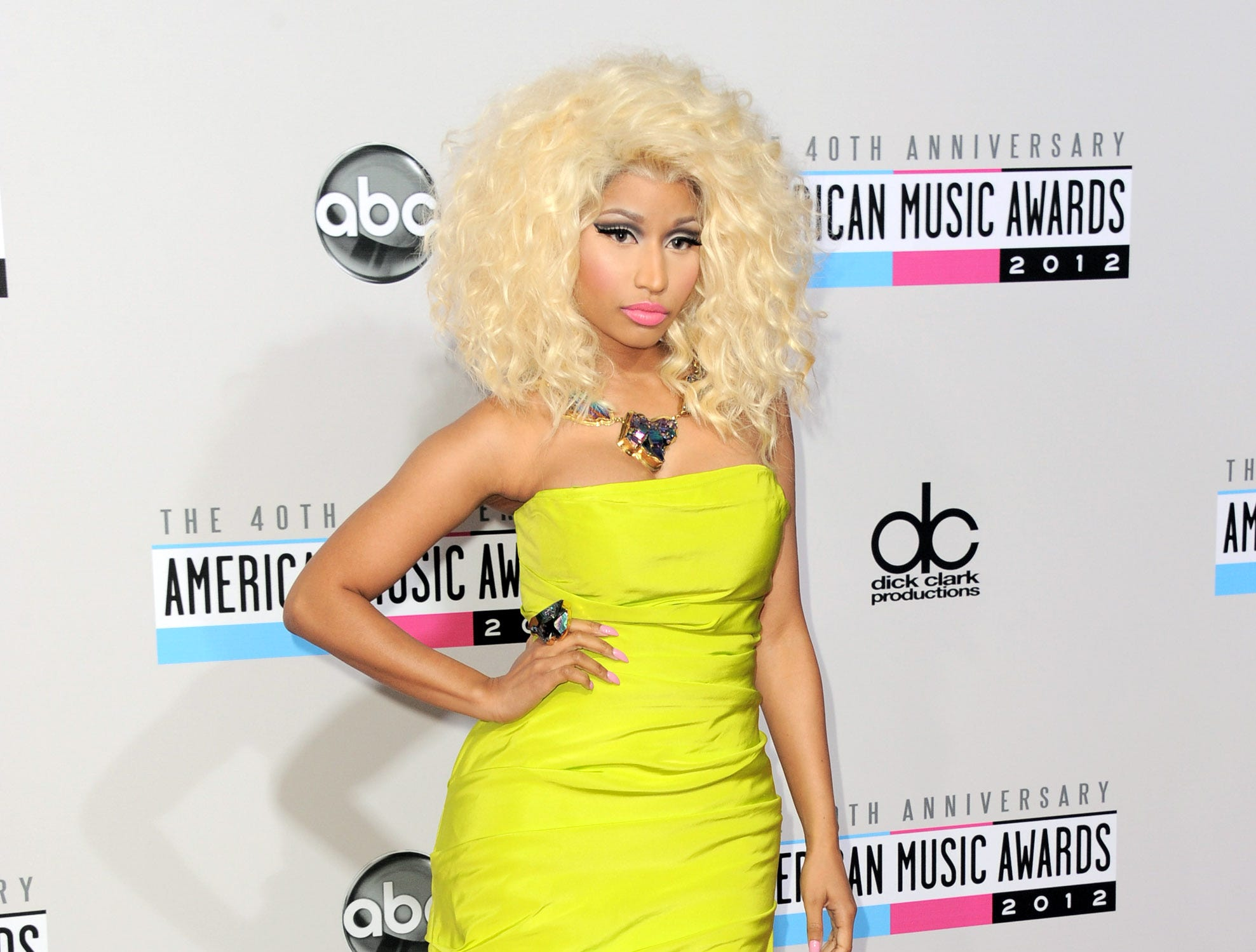 FILE- In this Nov. 18, 2012 file photo, Nicki Minaj arrives at the 40th Anniversary American Music Awards, in Los Angeles.   Despite having a big year in music, Nicki Minaj didn't receive any Grammy nominations. The 30-year-old had one of last year's biggest hits with the multiplatinum dance-pop anthem ìStarships.î Her sophomore album, ìPink Friday: Roman Reloaded,î has reached gold status and launched other hits on the rap and R&B charts. But Minaj was shunned out when the Grammys announced this year's nominees, though the animated performer earned three nominations last year, including best new artist and best rap album for her platinum debut, ìPink Friday.î (Photo by Jordan Strauss/Invision/AP, File) ORG XMIT: CAENT588
