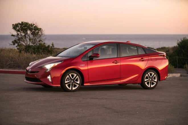 This undated photo provided by Toyota shows the 2018 Toyota Prius. The standard Prius offers 52 mpg. (David Dewhurst Photography/Courtesy of Toyota Motor Sales via AP)