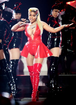 """Nicki Minaj performs onstage at the 2018 BET Awards at Microsoft Theater in Los Angeles, Calif. Minaj said Monday on Twitter that she would not attend the Met Gala because of a COVID vaccination requirement.  """"They want you to get vaccinated for the Met. if I get vaccinated it won't for the Met,"""" she tweeted. """"It'll be once I feel I've done enough research. I'm working on that now. In the meantime my loves, be safe. Wear the mask with 2 strings that grips your head & face. Not that loose one."""""""