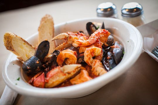 At Mud City Crab House in Stafford, cioppino is served in a spicy red sauce over linguini.