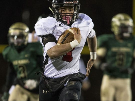 Leo Shimonovich, shown running for a touchdown last year against Brick Memorial in a NJSIAA Central Group IV quarter last season, is one of Jackson Memorial's leading returnees.