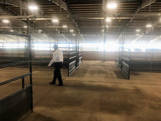Taylor County Judge Downing Bolls checks out the stalls at the new livestock barn at the Taylor County Expo Center on Thursday. The barn will be used for the first time in two weeks for the West Texas Fair & Rodeo.