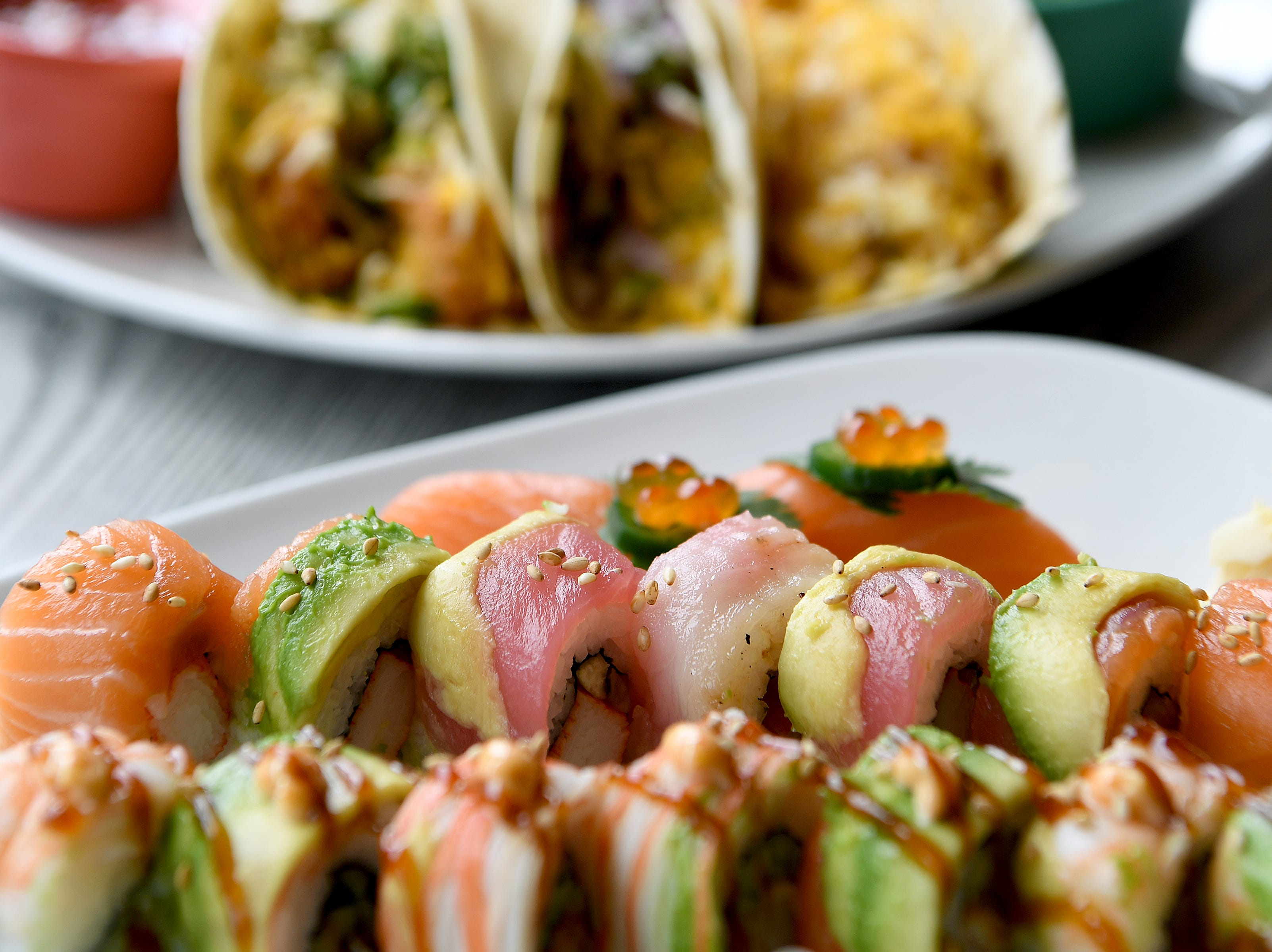 """A platter of """"takos"""" and a platter of sushi show the Far East Southwest clash of menu choices at Takosushi."""