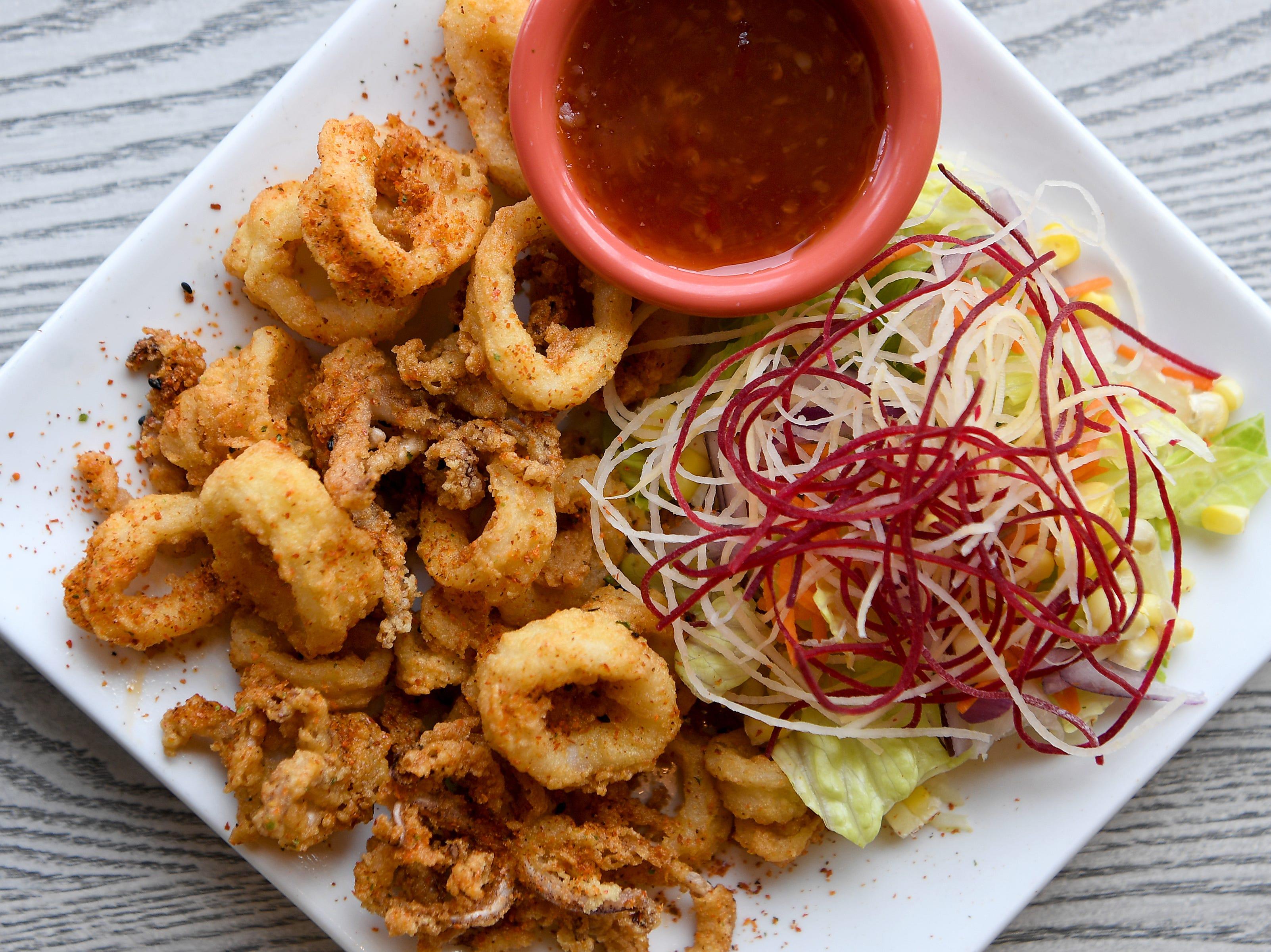 The crispy fried calamari at Takosushi is seasoned with Togarishi pepper and served with Asian sweet chili sauce.
