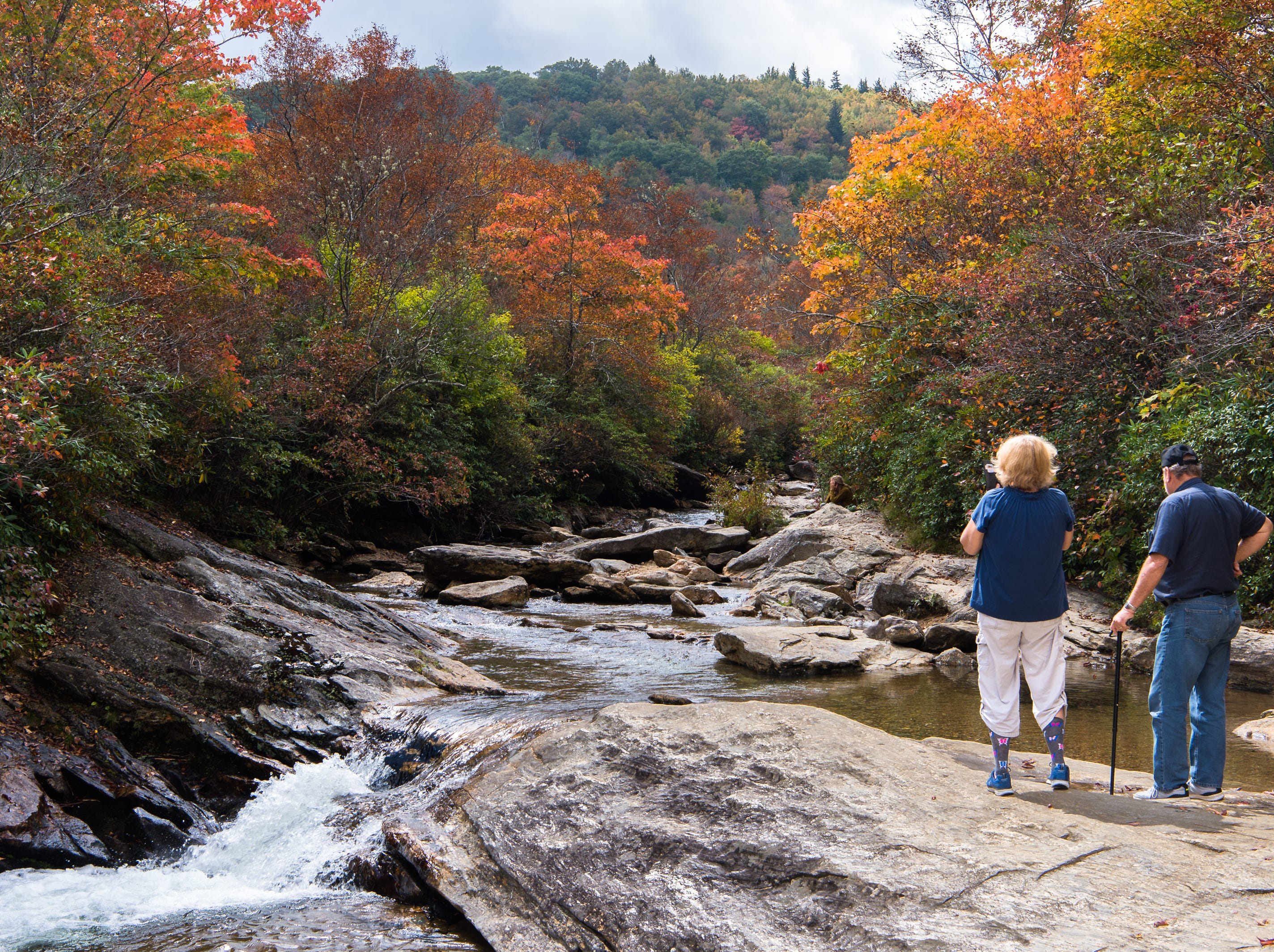Cathy Cartica and her husband Mike Cartica, of Young Harris Georgia, take in the view at the lower falls at Graveyard Fields on the Blue Ridge Parkway, Wednesday, September 20, 2017.