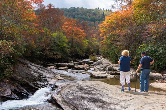 Cathy Cartica and her husband, Mike Cartica, of Young Harris, Georgia, take in the view at the lower falls at Graveyard Fields on the Blue Ridge Parkway in September 2017.