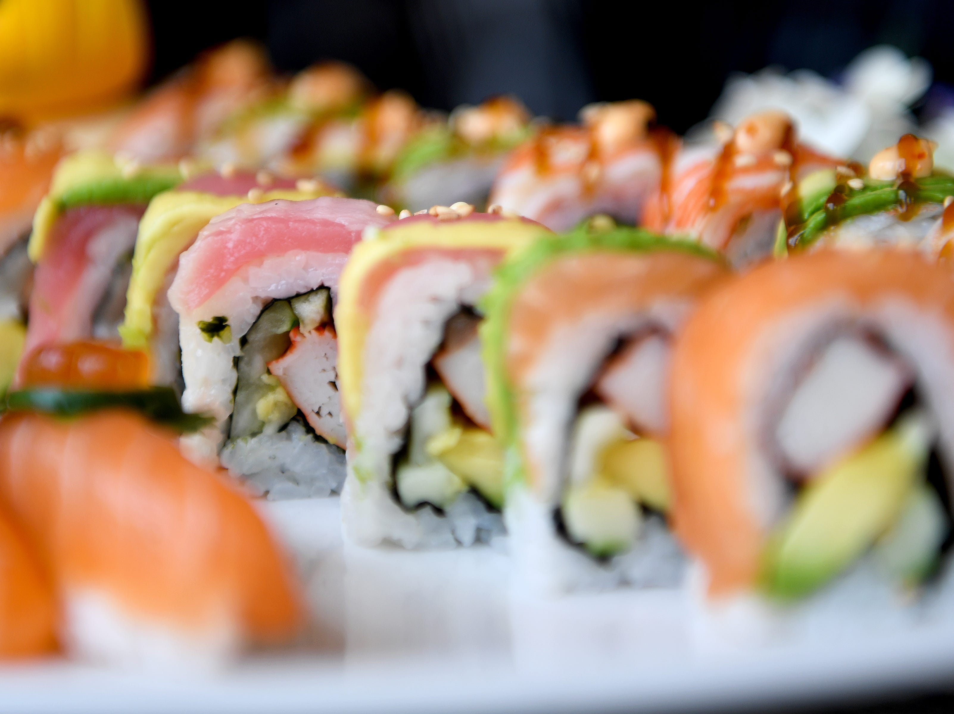 The rainbow roll at Takosushi features crab, and cucumber, topped with avocado, eel, tuna, escolar and salmon.