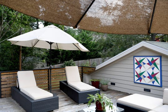 Mary Ann Myers and Annie Lundahl moved into town from 15 acres in Sandy Mush so when designing their North Asheville home still having the presence of the outdoors was important to them. They have two rooftop deck areas to enjoy and entertain. The second has a hot tub.