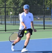 Harper Creek's Storm Rowles plays at No. 3 singles during the All-City Tennis Tournament at Harper Creek on Thursday.
