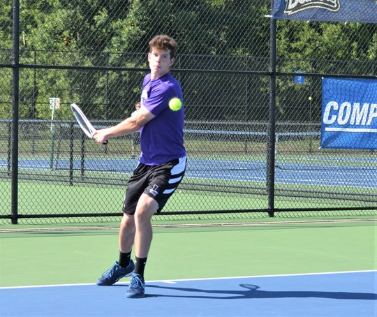Lakeview's Cole Einhardt playing No. 3 singles during the All-City Tennis Tournament at Harper Creek on Thursday.