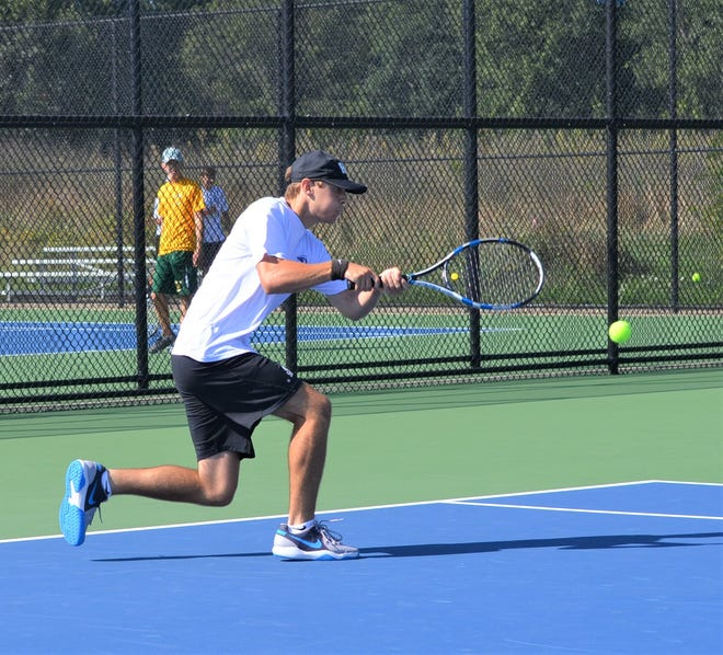 Harper Creek's Mason Bauer plays at No. 1 singles during the All-City Tennis Tournament at Harper Creek on Thursday.