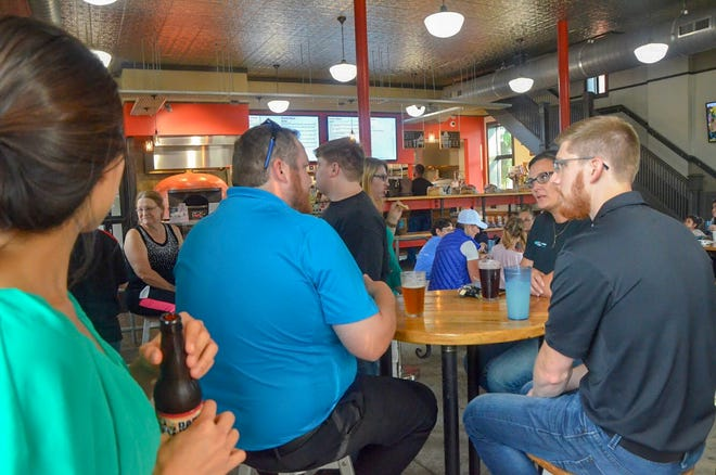 After packing 200 back-to-school kits and sorting 4,500 books, volunteers for United Way of the Battle Creek and Kalamazoo Region went to the Fire Hub for a drink and to mingle.