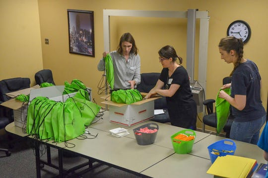 Volunteers for United Way of the Battle Creek and Kalamazoo Region spent the afternoon of Wednesday, Aug. 22, 2018, packing back-to-school kits for children.