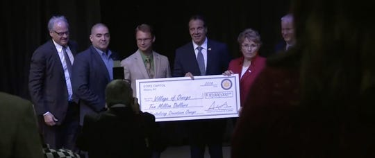 Govenor Andrew Cuomo presents a $10 million downtown revitalization award to the village of Owego Tuesday.