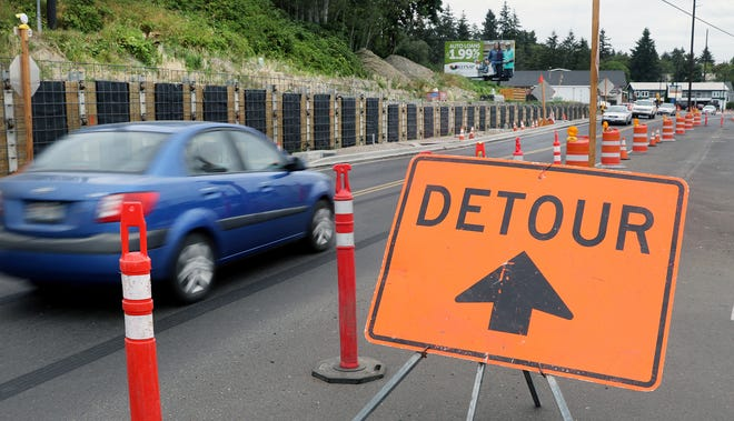 Traffic runs along the work project on Silverdale Way in Old Town as Operating engineers from Local 302 are striking, suspending the Silverdale Way project, on Thursday, August 23, 2018.