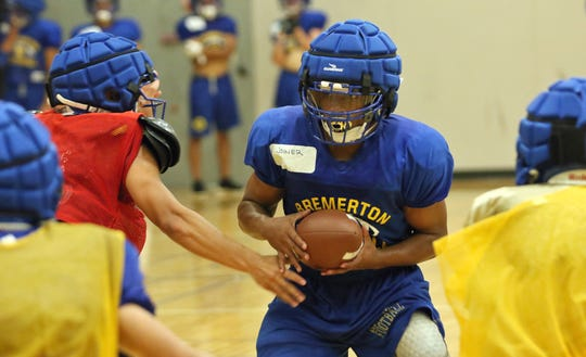 Bremerton running back Rashed Joiner looks for an opening after receiving a hand off from quarterback Kelo Logova.