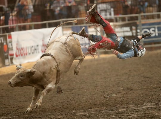 Bull rider Trey Benton III, of Rock Island, Texas, soars through the air off the back of a bull names Single Wide during the PRCA Xtreme Bulls at the Kitsap County Fair & Stampede on Wednesday, August 22. 2018.
