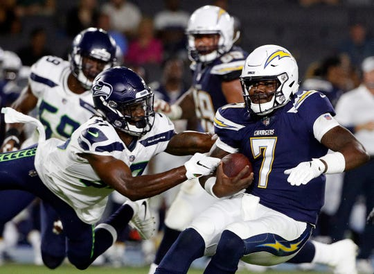 Seahawks cornerback Tre Flowers tackles Chargers quarterback Cardale Jones during Saturday's preseason game in Carson, Calif. Flowers is competing with Dontae Johnson and Byron Maxwell to be Seattle's starting right cornerback.