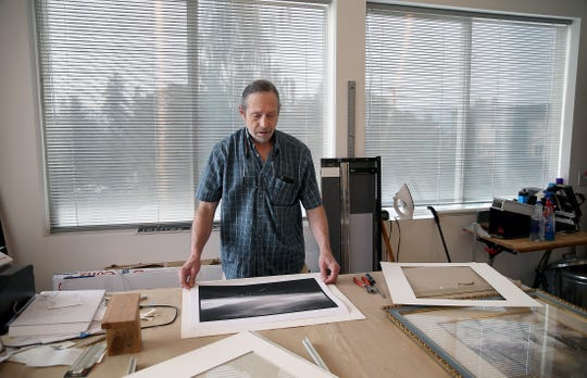 After 23 years in Seattle's Rainier Square, longtime Lemolo resident Jeffrey Moose has relocated his art gallery to Winslow Way in Bainbridge Island. He is getting a boarder mat  set for a black and white photo frame.