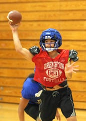 Bremerton quaterback Kelo Logova finds an open receiver during an indoor practice.
