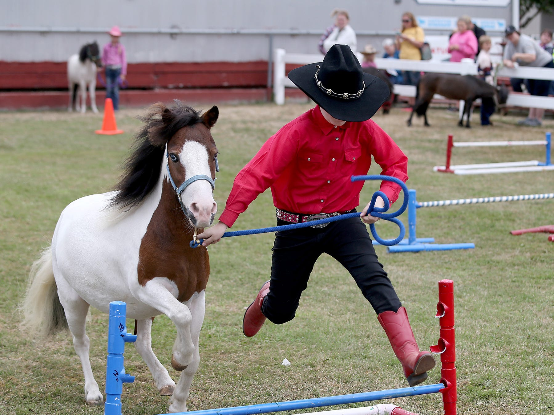 Gracie Lambert goes over the jump to lead her horse Mikey in the mini horse jumping open 10 & under amateur at the Kitsap County Fair & Stampede on Thursday, August 23, 2018, at the Kitsap County Fairgrounds.The fair goes from 10 a.m. until 10 p.m..