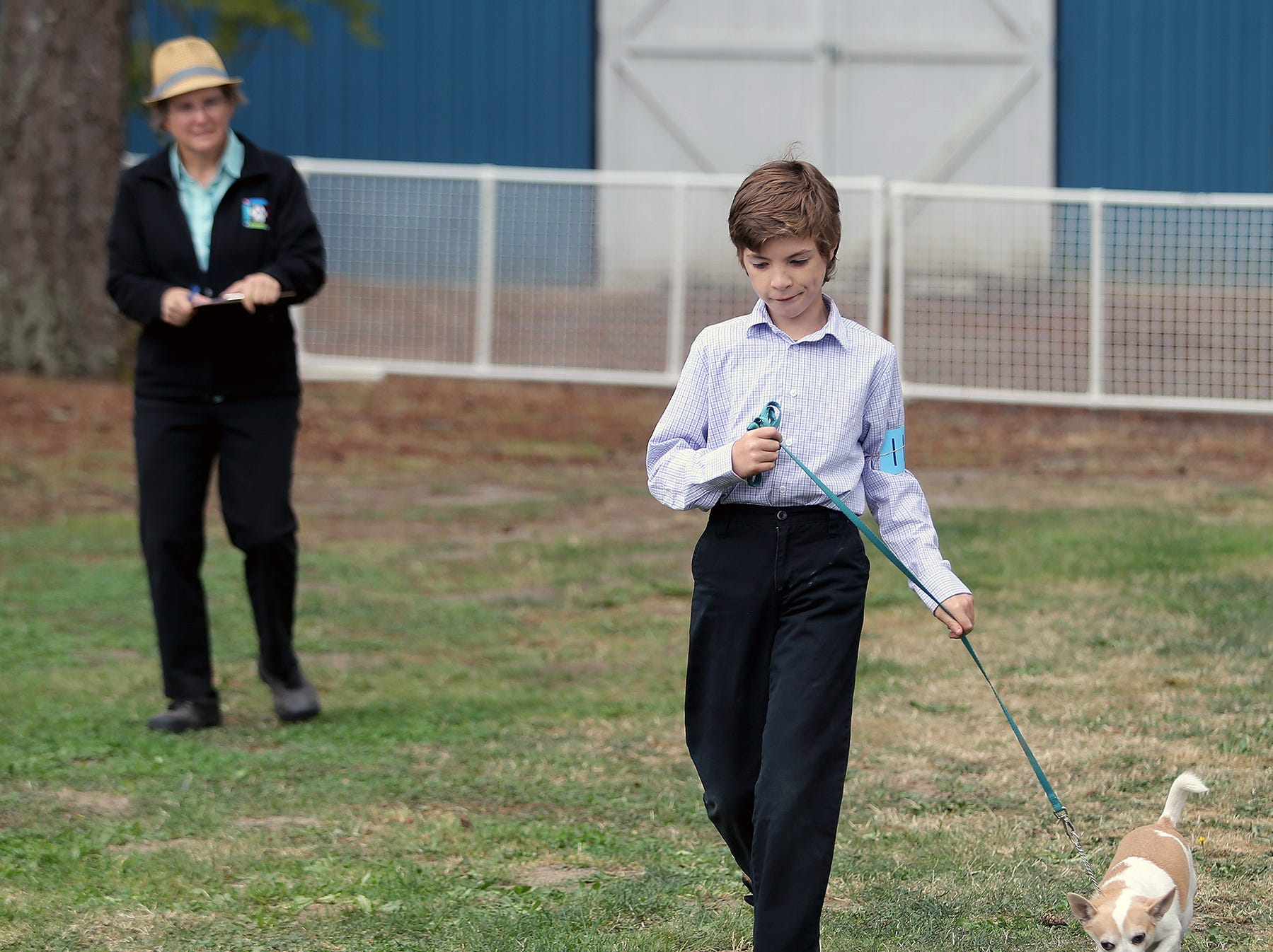 Michael Tabor, 10, of Bremerton takes his dog Dexter out for judging in the beginner obedience class at the Kitsap County Fair & Stampede on Thursday, August 23, 2018, at the Kitsap County Fairgrounds.The fair goes from 10 a.m. until 10 p.m..It was his first time showing at the fair and had already picked up one blue ribbon.