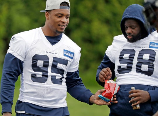 Seahawks defensive tackles Dion Jordan (95) and Shamar Stephen (98) share a snack during a June practice in Renton. When the Seahawks looked to bolster the interior of its defense in the offseason, it looked to Minnesota for the help. The Seahawks signed former Vikings defensive linemen Tom Johnson and Shamar Stephen.