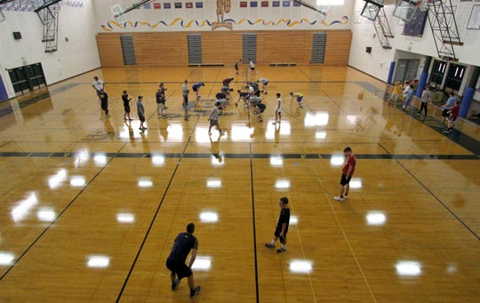 Bainbridge's football team runs through an indoor practice.