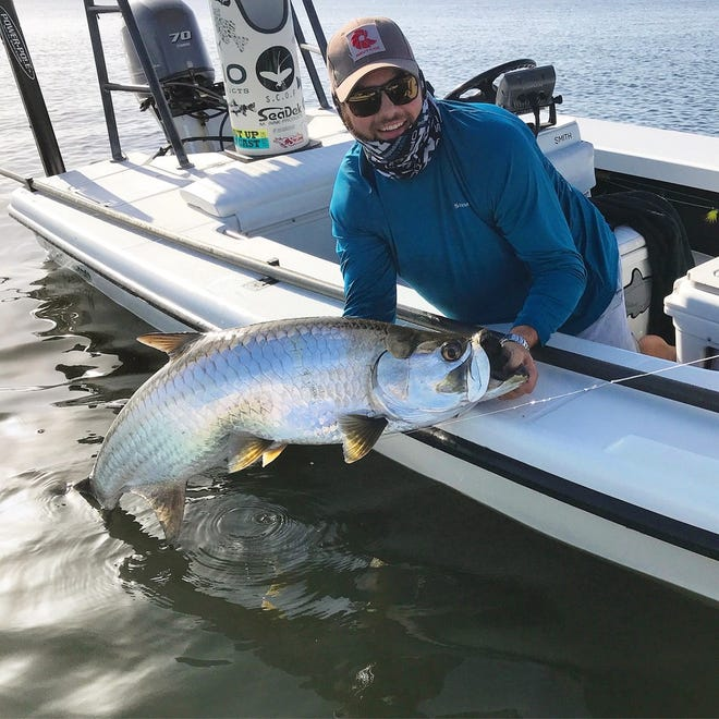 Eric Dudley definitely had a stroke of good beginner's luck when he landed this 50-pound tarpon. It was his first saltwater fish taken on fly fishing tackle. Dudley brought the tarpon to the boat during a recent trip on the Indian River Lagoon with Capt. Rick Worman of Merritt Island. Tarpon to 125 pounds have been released during the summer months by lagoon fly fishermen.