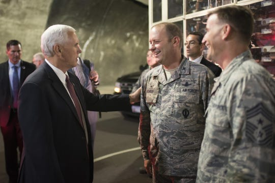 Vice President Mike Pence speaks with then-Col. Doug Schiess, 21st Space Wing commander, and Chief Master Sgt. Mark Bronson (right) at Cheyenne Mountain Air Force Station in June 2017 in Colorado.