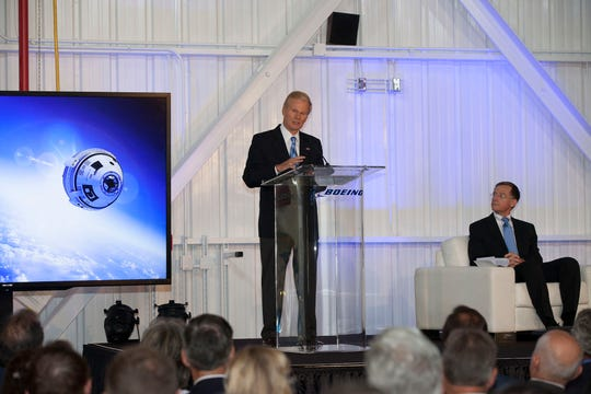 On Sept. 4, 2015, U.S. Sen. Bill Nelson spoke to attendees at the grand opening of Boeing's Commercial Crew and Cargo Processing Facility, a former shuttle hangar and engine shop at NASA's Kennedy Space Center. Chris Ferguson of Boeing's Commercial Crew Program, listened at right. During the event, the company also revealed the new name of its commercial crew transportation spacecraft: the CST-100 Starliner.