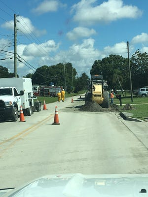 Crews dig up the road where a gas line broke in West Melbourne Thursday morning.