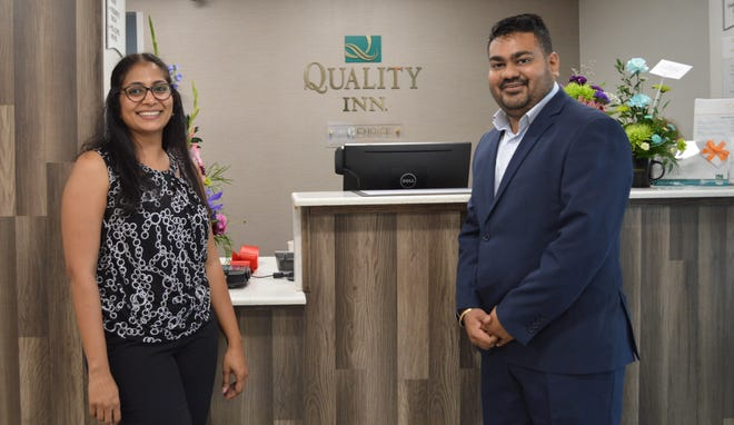 Heena and Vyom Patel stand by the front desk of the new Quality Inn in Bucyrus.