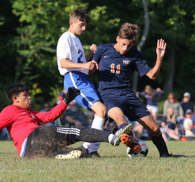 Galion's Walker Frankhouse attempts to kick a goal during a home game against Highland.