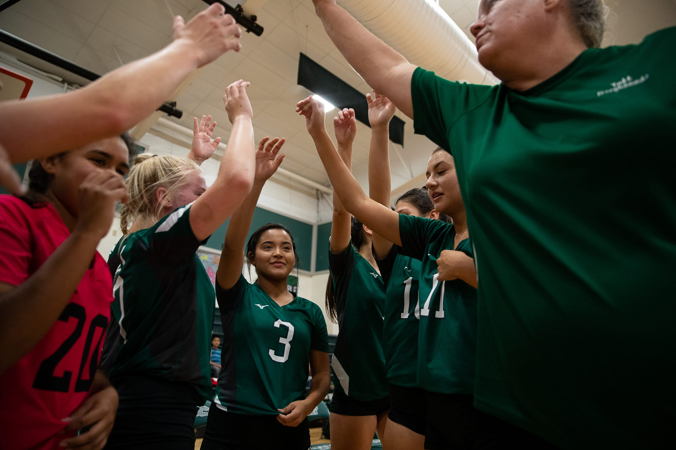 Taft players huddle between games in their newly rebuilt gymnasium on Thursday, Aug. 23, 2018. Their  gym was heavily damaged during Hurricane Harvey and have played and practiced on the road in 2017.