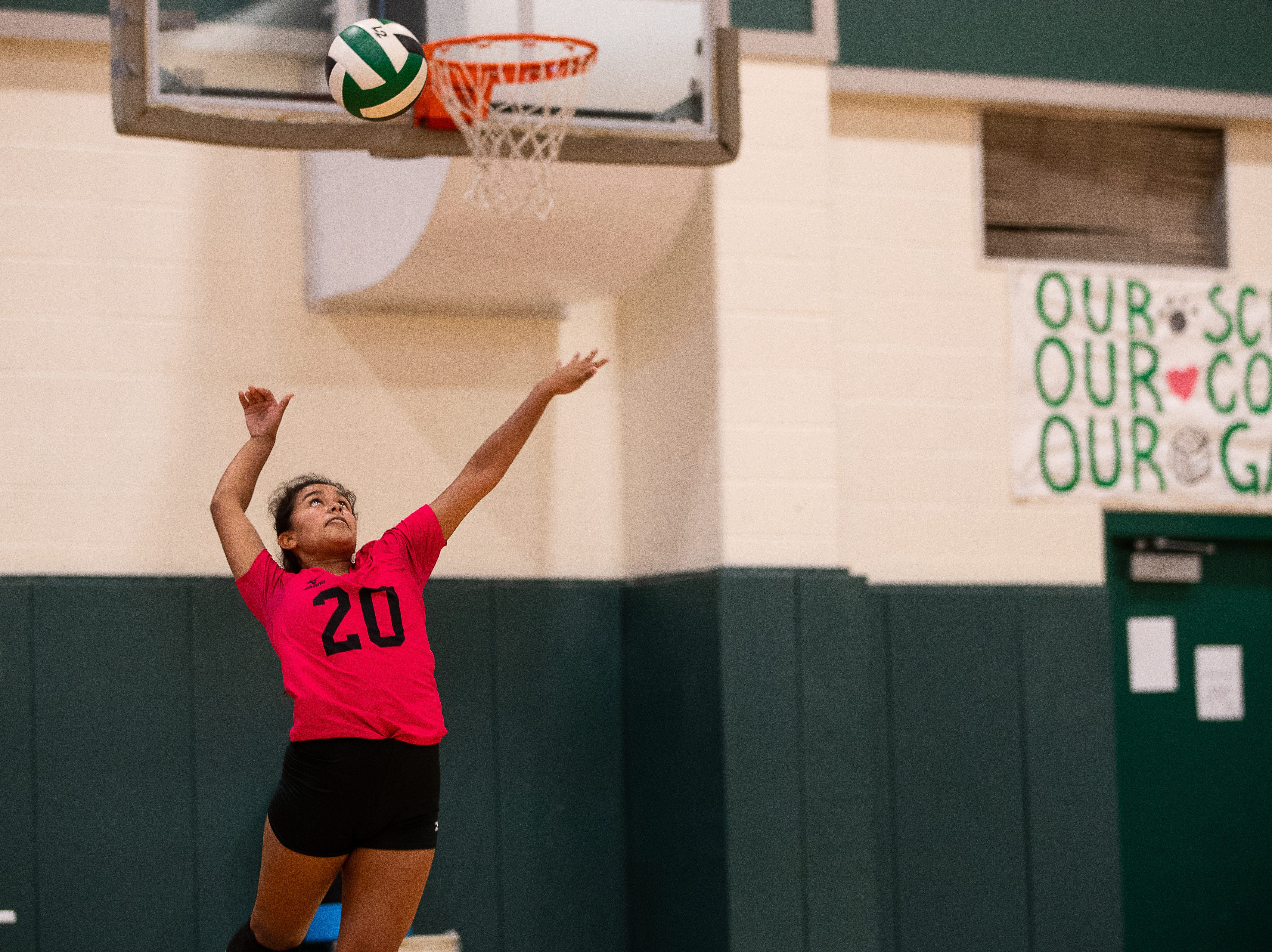 Taft's Aubrey Banda jumps to surf the ball during a game in their newly rebuilt gymnasium on Thursday, Aug. 23, 2018. Their  gym was heavily damaged during Hurricane Harvey and have played and practiced on the road in 2017.
