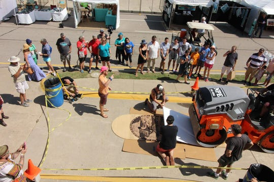 Festival-goers can watch a live demonstration of steamroll print making at Arts Alive Festival Sept. 1 and 2.