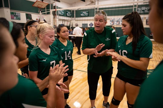 Taft's head coach Tasha Wilson talks to her players after winning a game in their newly rebuilt gymnasium on Thursday, Aug. 23, 2018. Their  gym was heavily damaged during Hurricane Harvey and have played and practiced on the road in 2017.