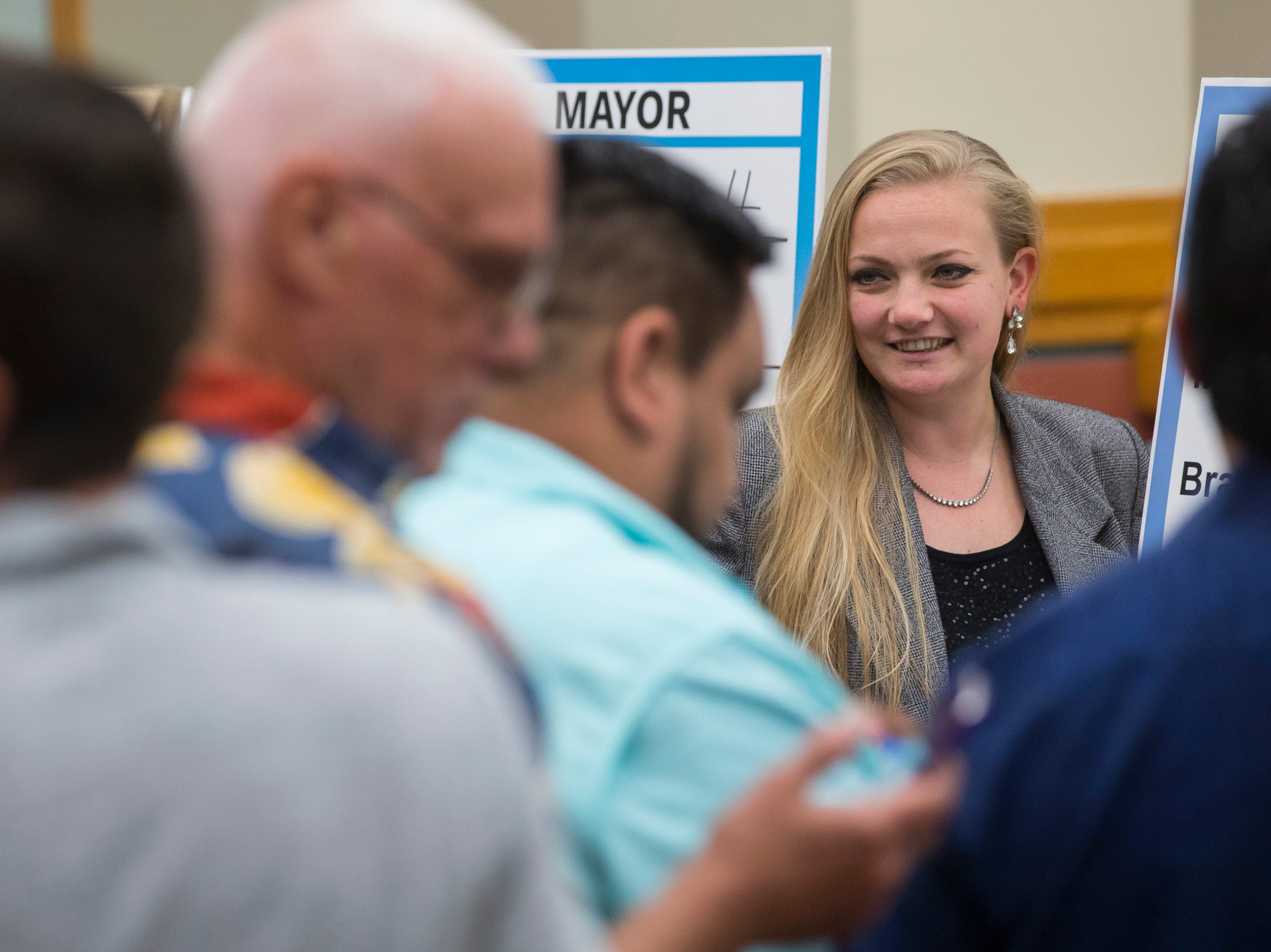 City Council candidate Kaylynn Paxson talks with other candidates after drawing for their ballot order on Thursday, August 23, 2018 at City Hall.