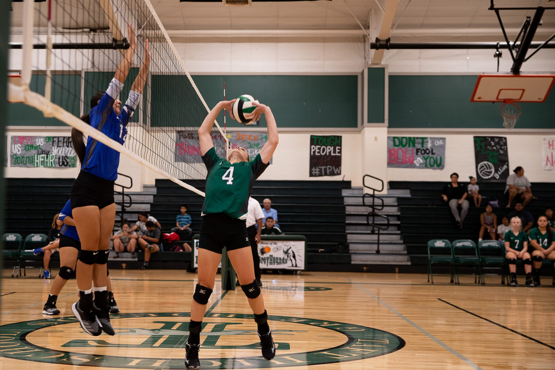 Taft's Kelly Graves sets the ball during a game in their newly rebuilt gymnasium on Thursday, Aug. 23, 2018. Their  gym was heavily damaged during Hurricane Harvey and have played and practiced on the road in 2017.