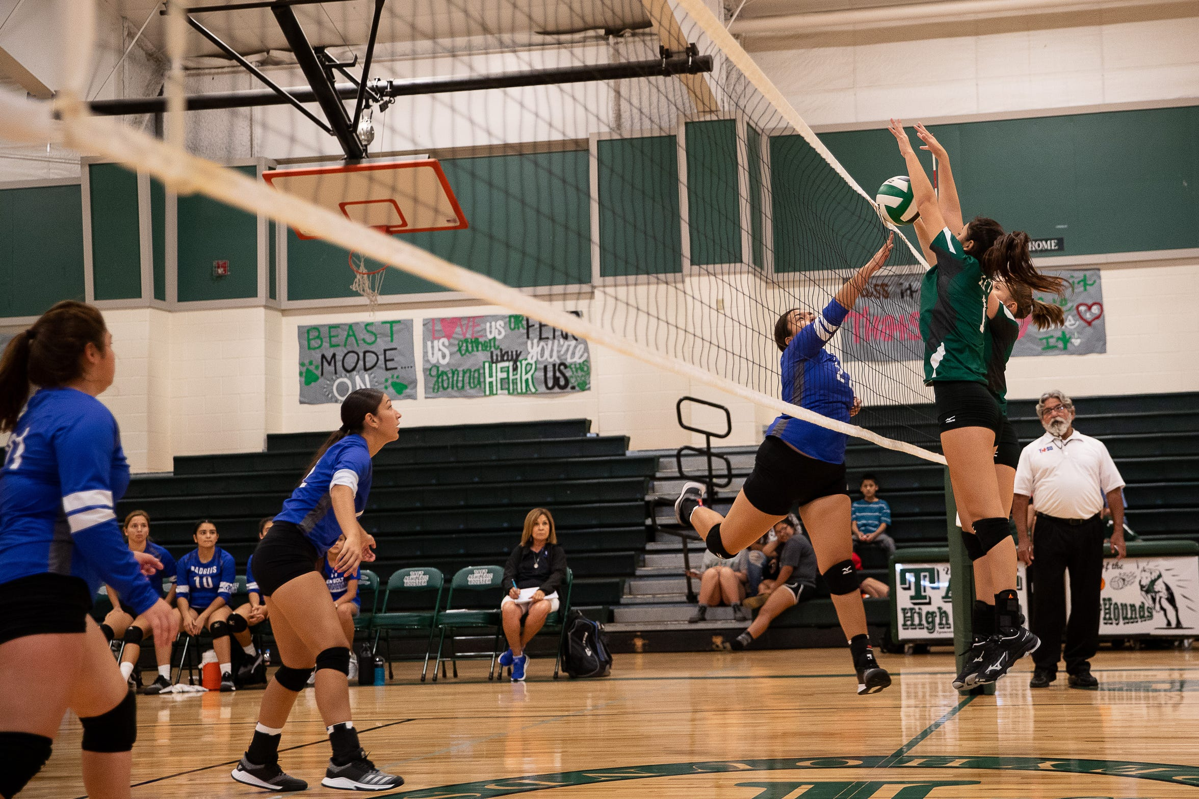 Taft players jump to block a spike during a game in their newly rebuilt gymnasium on Thursday, Aug. 23, 2018. Their  gym was heavily damaged during Hurricane Harvey and have played and practiced on the road in 2017.
