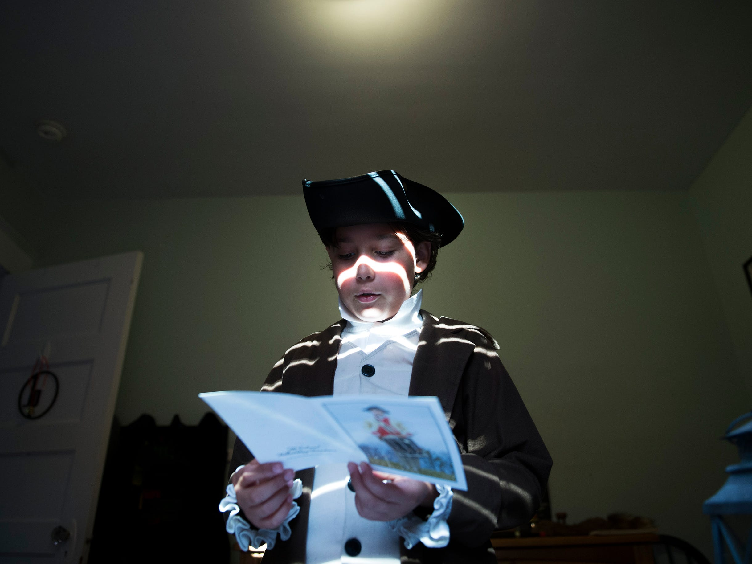 Colonial history buff Joseph Gentile, 9, reads in his bedroom Thursday, Aug. 9, 2018 in Haddon Heights, N.J.