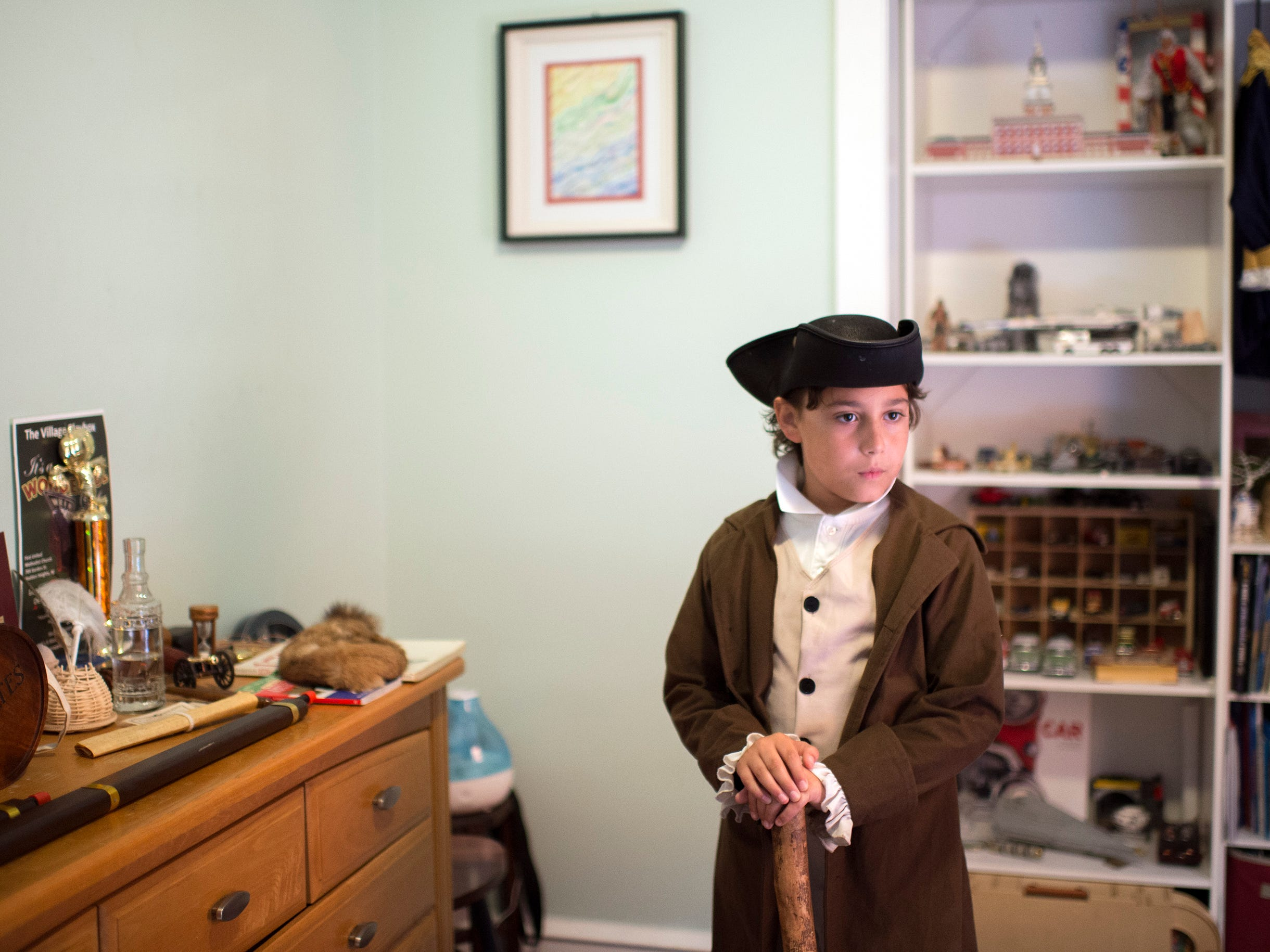 Joseph Gentile, 9, wears his colonial outfit in his bedroom Thursday, Aug. 9, 2018 in Haddon Heights, N.J.
