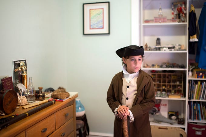 Joseph Gentile, 9, wears his colonial outfit in his bedroom in Haddon Heights
