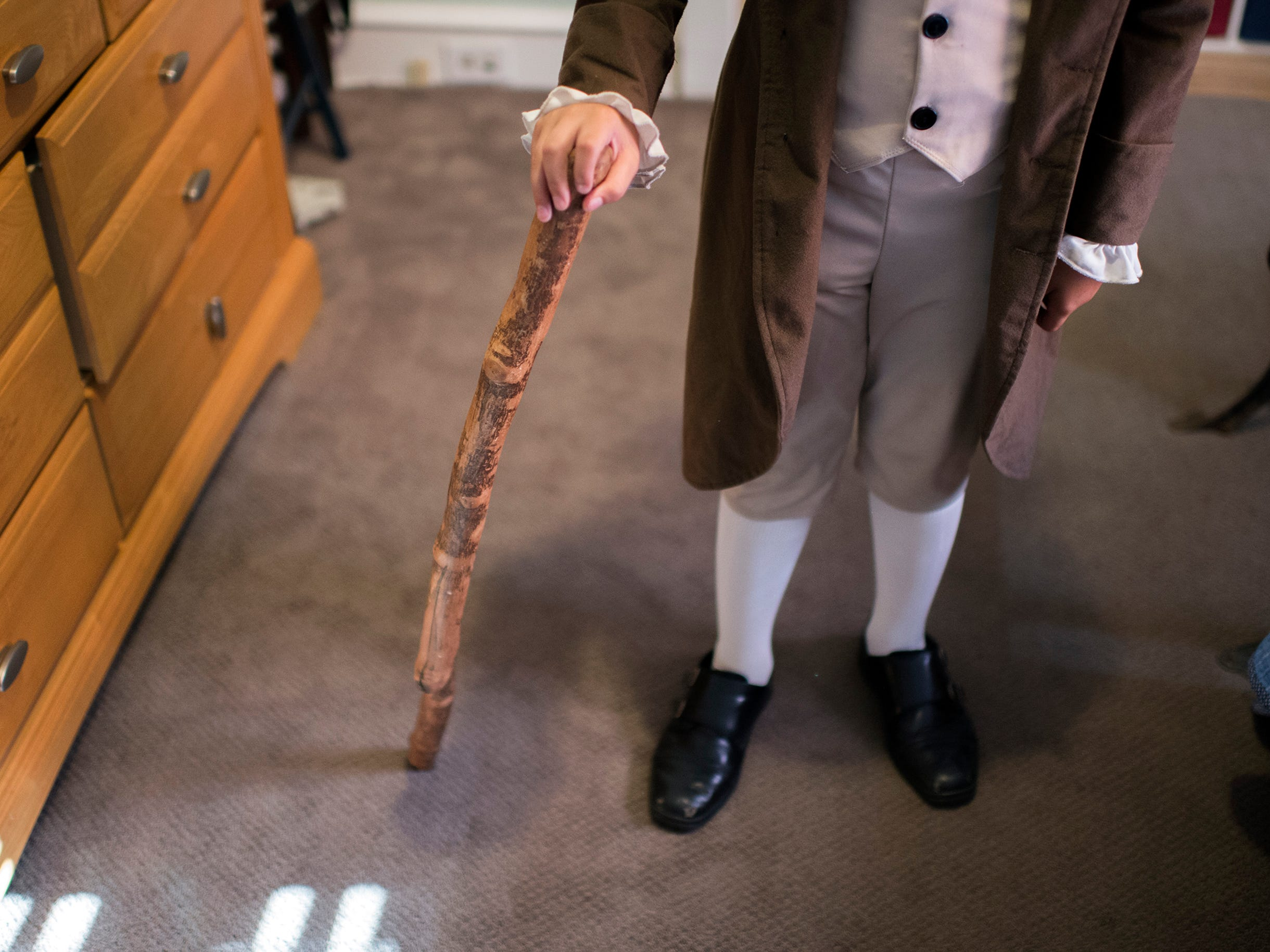 Joseph Gentile, 9, shows off his walking stick at home Thursday, Aug. 9, 2018 in Haddon Heights, N.J.