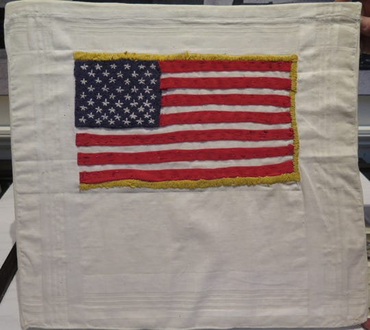 American flag sewn in captivity from threads of cloth during the Vietnam War by POW and Blackwood native John Dramesi is on display at the Richard Nixon Presidential Library and Museum in Yorba Linda,  California.